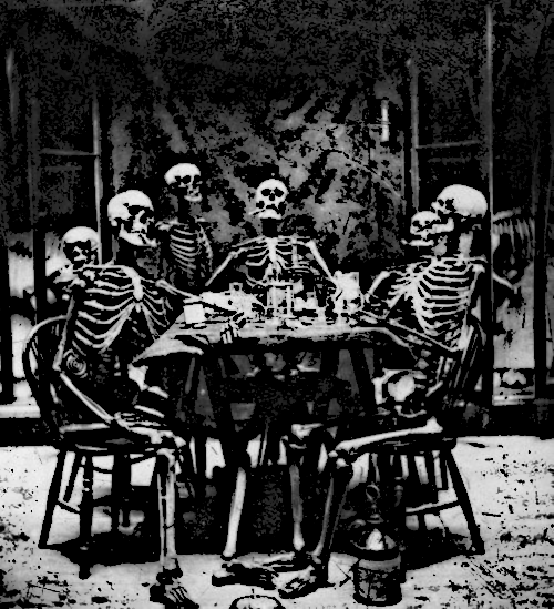 Skeletons_around_a_table_-_cartoon.png
