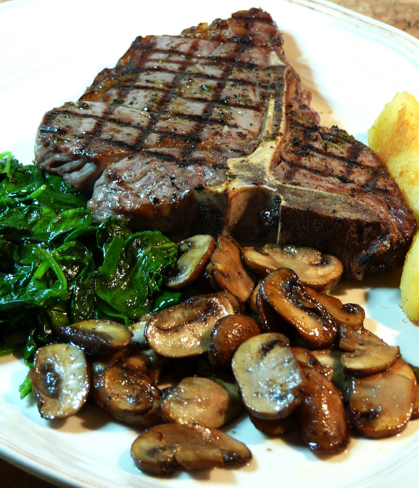 T-Bone_Steak_with_Mushrooms_and_Spinach_Feb_24th__2012.jpg