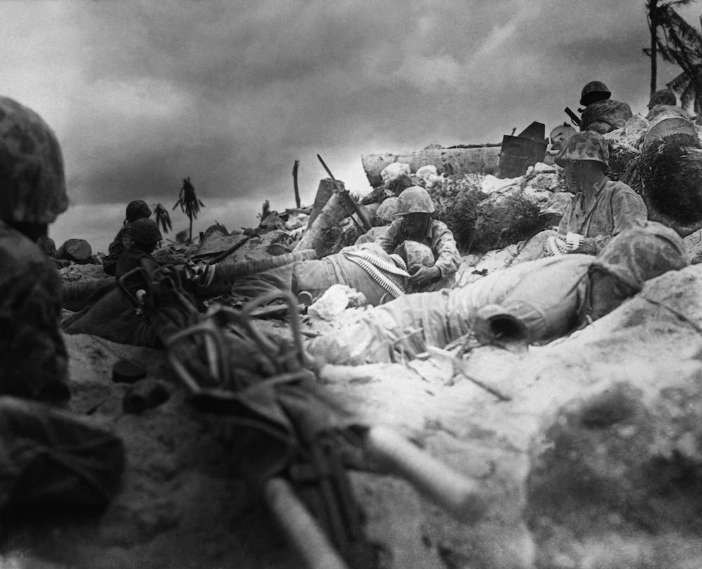 Marines_take_cover_behind_seawall_at_Red_Beach_no._3__Tarawa.JPEG