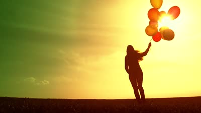 stock-footage-cheerful-happy-woman-enjoying-nature-beautiful-sky-balloons.jpg