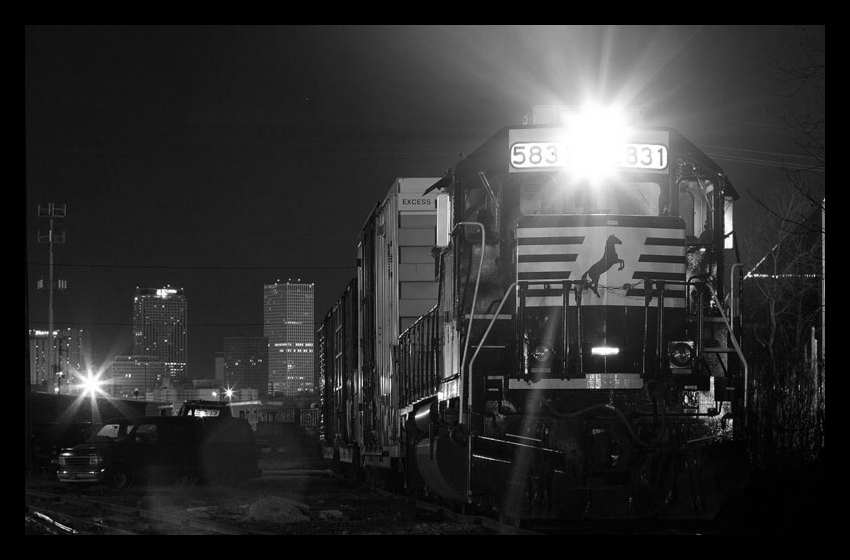 029803-RGB-wjj-_-NS-5831-prepares-to-leave-Bernadotte-Yard-with-three-empty-boxcars-from-Masonry-Products-after-spotting-two-loads-seen-in-distance-2008-03-116.jpg