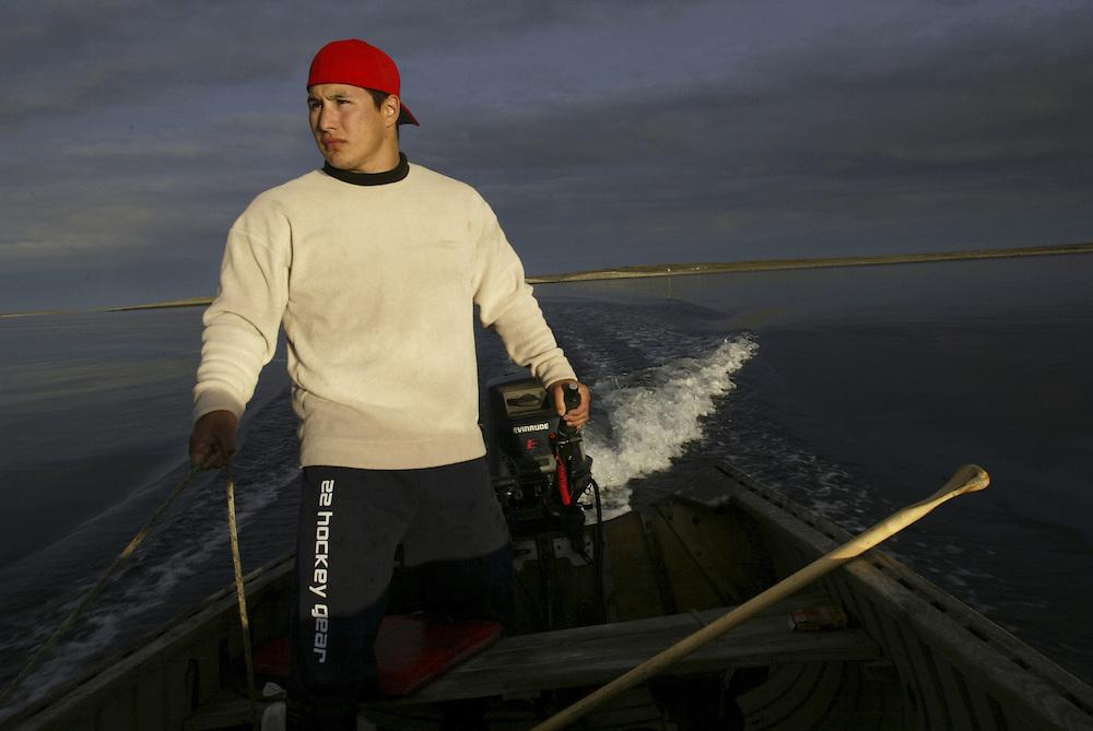 Hockey-Player-Jordin-Tootoo-in-boat-on-Hudson-Bay.jpg