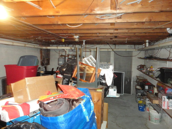 13542-an-unfinished-basement-with-no-storage-space-at-a-home-in-bridgeport-ct.jpg