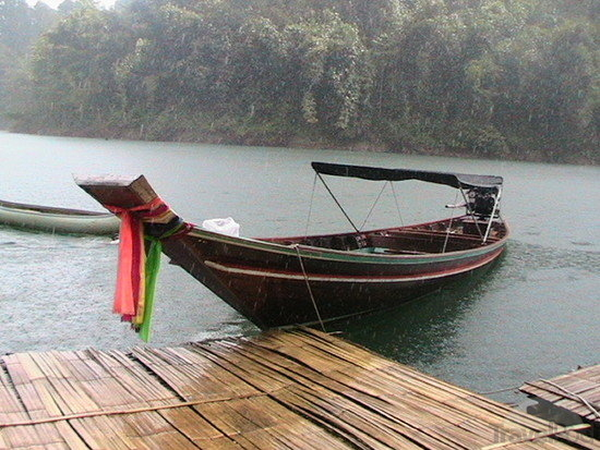 Long-tail-boat-in-the-rain-takua-pa.jpg