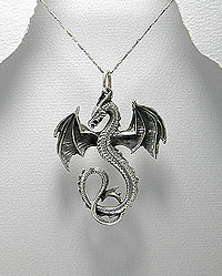 Silver pendant adorned with the holy symbol of Bahamut